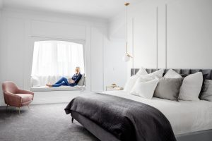 Luxury adult bedroom with a reading alcove by the window